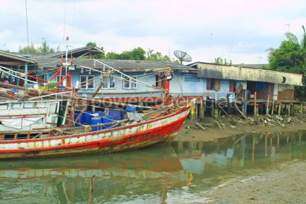 Transportation: Fishermen's huts and old fishing boat in South of Thailand #04749