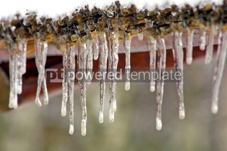Nature: Long icicles on a wooden roof #04838