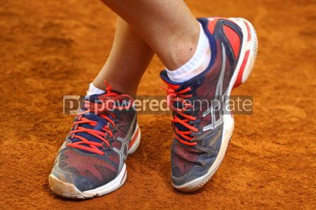Sports : Tennis player legs on the clay court #04989