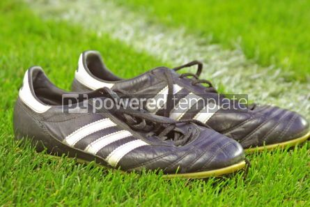 Sports : Football boots on the grass #04991