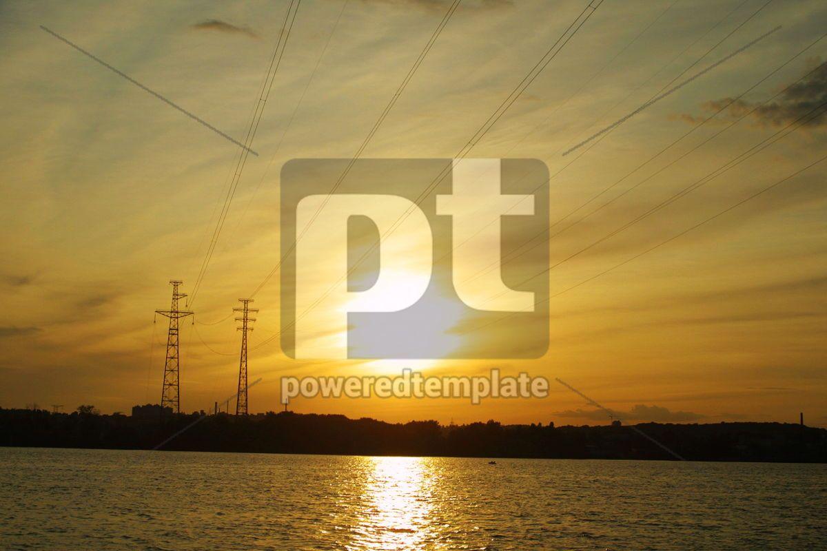 Sun setting behind electricity pylon, 05026, Industrial — PoweredTemplate.com