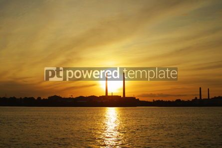 Industrial: Sun setting behind power plant pipes #05027