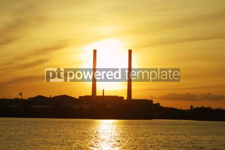 Industrial: Sun setting behind power plant pipes #05028