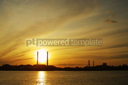 Industrial: Sun setting behind power plant pipes #05029