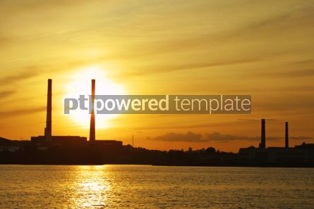 Industrial: Sun setting behind power plant pipes #05030