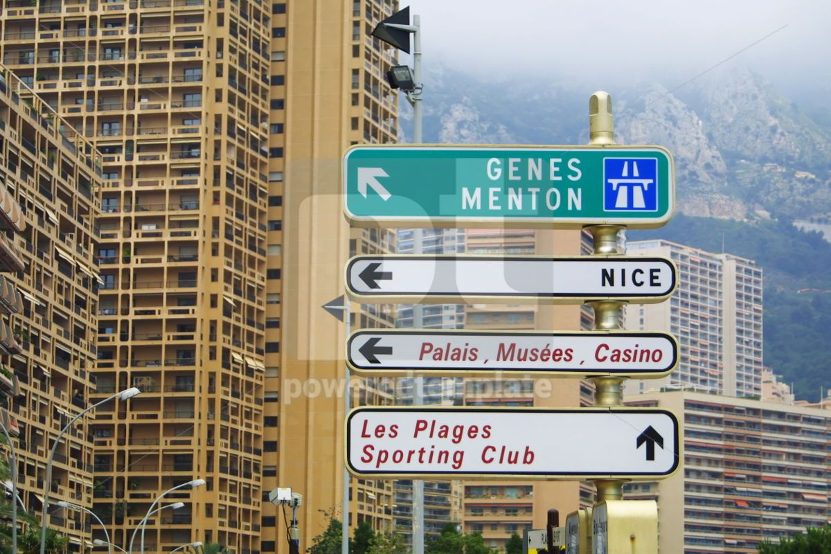 Direction signs on a post in Monte Carlo, 05033, Transportation — PoweredTemplate.com