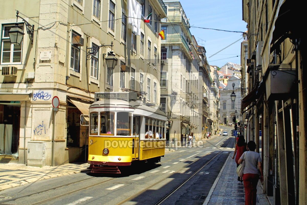 Typical yellow tram in Lisbon, 05050, Transportation — PoweredTemplate.com