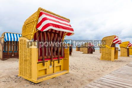 Architecture : Hooded beach chairs (strandkorb) at Baltic seacoast in Travemund #05208