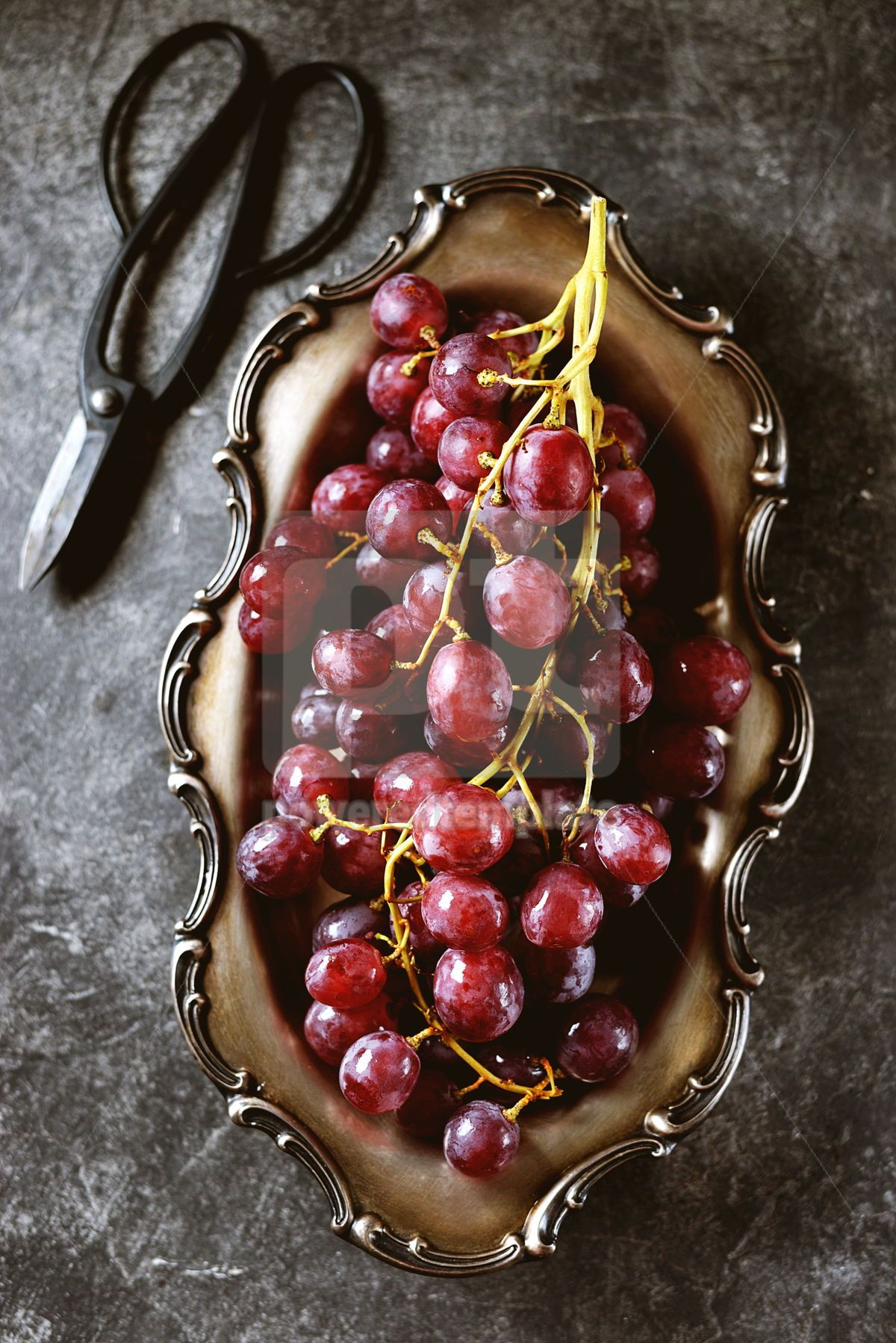 Red grapes in cupronickel platter on a gray background., 05224, Food & Drink — PoweredTemplate.com