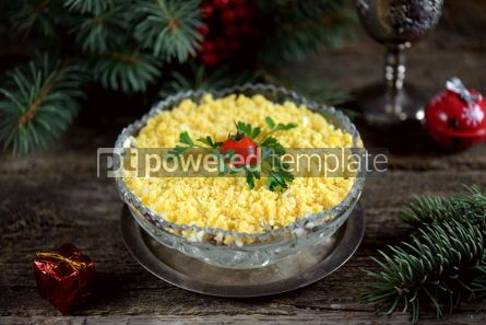 "Food & Drink: Traditional New Year's Russian salad ""Mimosa"" with cannad fish potatoes cheese carrots and eggs. #05228"
