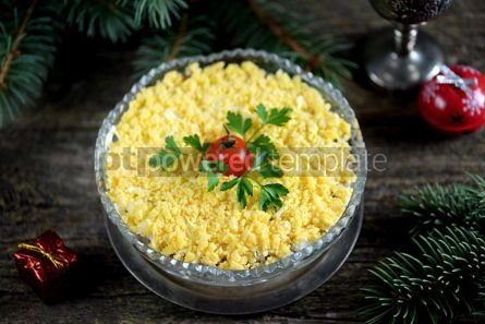 "Food & Drink: Traditional New Year's Russian salad ""Mimosa"" with cannad fish potatoes cheese carrots and eggs. #05229"