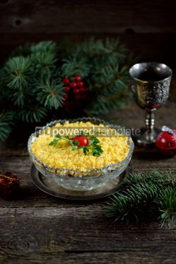 "Food & Drink: Traditional New Year's Russian salad ""Mimosa"" with cannad fish potatoes cheese carrots and eggs. #05230"