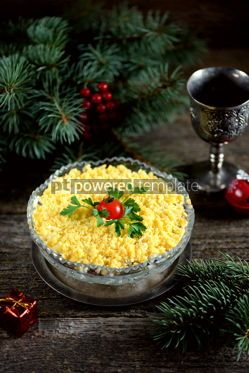 "Food & Drink: Traditional New Year's Russian salad ""Mimosa"" with cannad fish potatoes cheese carrots and eggs. #05231"