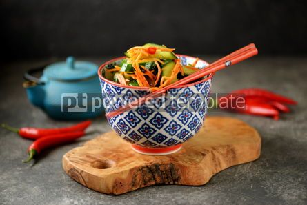 Food & Drink: Spicy Asian cucumber appetizer with carrots coriander chili peppers garlic #05236