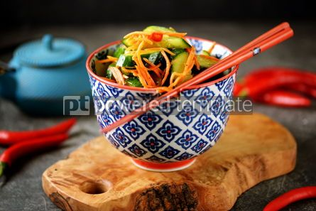 Food & Drink: Spicy Asian cucumber appetizer with carrots coriander chili peppers garlic #05237
