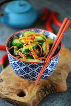 Food & Drink: Spicy Asian cucumber appetizer with carrots coriander chili peppers garlic #05238