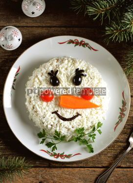 "Food & Drink: Traditional Russian New Year's salad ""Snowman"" on an old wooden background. #05240"