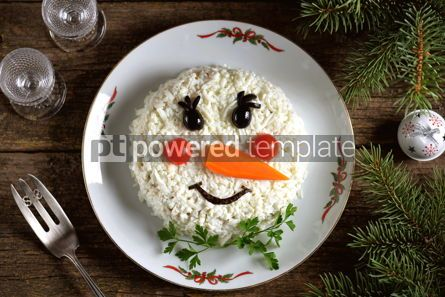 "Food & Drink: Traditional Russian New Year's salad ""Snowman"" on an old wooden background. #05241"