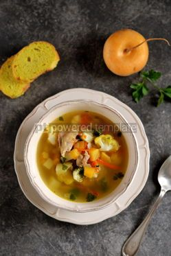 Food & Drink: Chicken soup with turnips carrots tomatoes and cauliflower. Top view.  #05249
