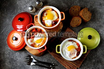 Food & Drink: Breakfast of chorizo bell pepper onion beans in tomato sauce with an egg in the oven. #05258