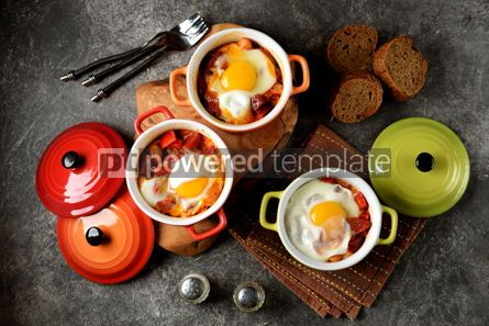 Food & Drink: Breakfast of chorizo bell pepper onion beans in tomato sauce with an egg in the oven. #05259
