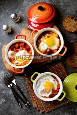 Food & Drink: Breakfast of chorizo bell pepper onion beans in tomato sauce with an egg in the oven. #05260