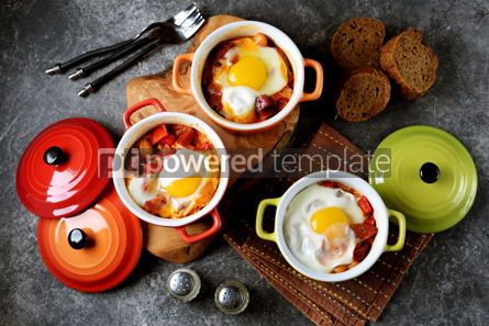 Food & Drink: Breakfast of chorizo bell pepper onion beans in tomato sauce with an egg in the oven. #05261