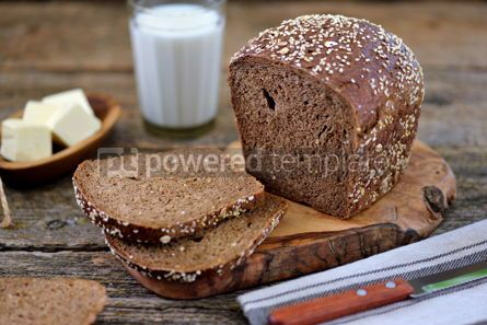 Food & Drink: Healthy rye bread with organic milk and butter on an old wooden background. #05262