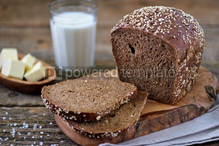 Food & Drink: Healthy rye bread with organic milk and butter on an old wooden background. #05263