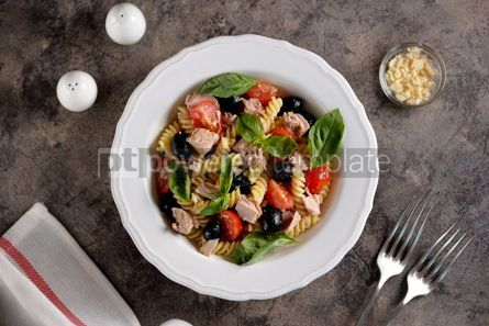 Food & Drink: Salad with canned tuna pasta cherry tomatoes olives parmesan olive oil and basil. Top view.  #05282