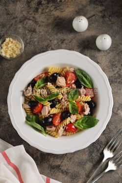Food & Drink: Salad with canned tuna pasta cherry tomatoes olives parmesan olive oil and basil. Top view.  #05284