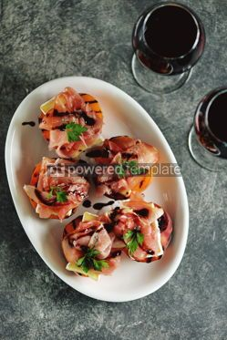 Food & Drink: Grilled peaches with soft brie cheese Parma ham and balsamic cream. #05285