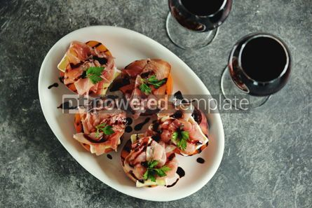 Food & Drink: Grilled peaches with soft brie cheese Parma ham and balsamic cream. #05286