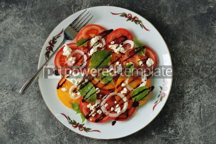 Food & Drink: Salad of yellow and pink tomatoes with basil soft cheese onions olive oil and balsamic cream. #05291