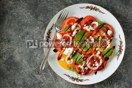 Food & Drink: Salad of yellow and pink tomatoes with basil soft cheese onions olive oil and balsamic cream. #05292
