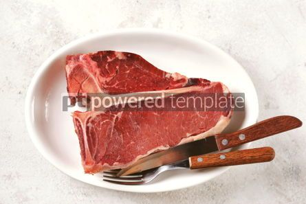 Food & Drink: Fresh raw organic beef t-bone steak on a light background. Top view.  #05294