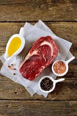 Food & Drink: Raw fresh beef steak rib eye on old wooden background. Rustik Style. Top view. #05301