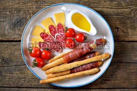 Food & Drink: Antipasti snacks - sausage homemade grissini with jamon cheese cherry tomatoes and olive oil.  #05342