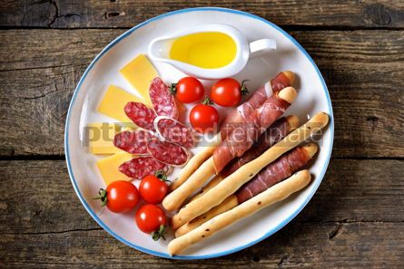 Food & Drink: Antipasti snacks - sausage homemade grissini with jamon cheese cherry tomatoes and olive oil.  #05347