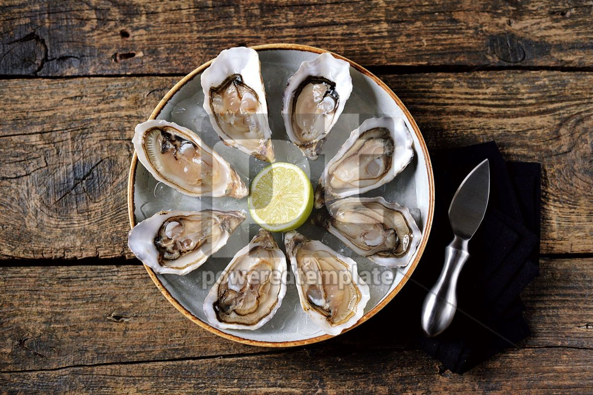 Fresh oysters with slices of lemon on ice on old wooden background. Top view. , 05349, Food & Drink — PoweredTemplate.com