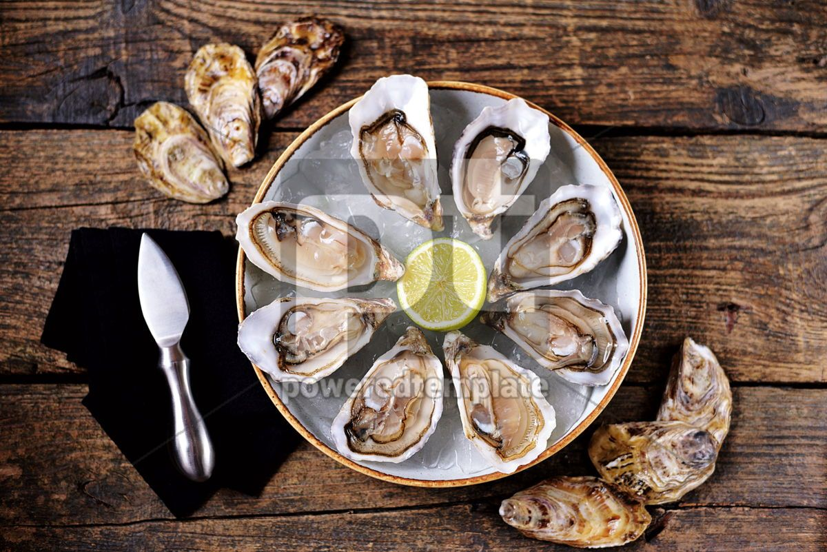 Fresh oysters with slices of lemon on ice on old wooden background. Top view. , 05350, Food & Drink — PoweredTemplate.com