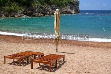 Nature: Two wooden chairs on empty beach in Sveti Stefan Montenegro #05522