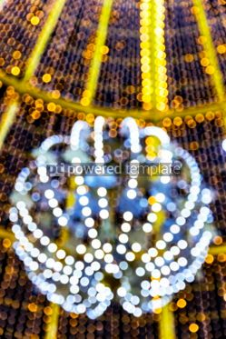 Holidays: Blurred illuminated bokeh of the lights of Christmas decorations #05543