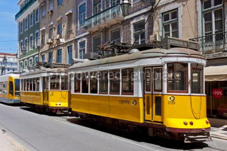 Transportation: Typical yellow trams on the street of Lisbon Portugal #05595