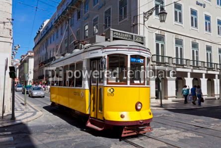 Transportation: Typical yellow tram on the street of Lisbon Portugal #05596