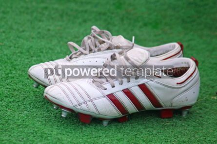 Sports : Pair of football boots on the grass #06993