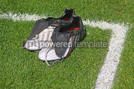 Sports : Pair of football boots on the grass #06994