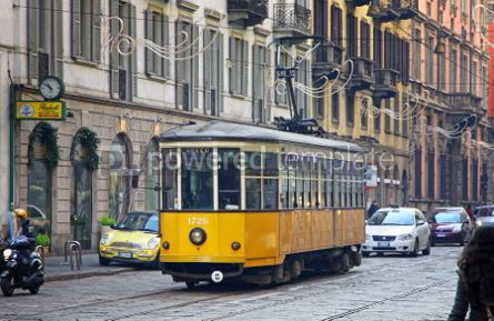 Transportation: Old traditional yellow tram on the street of Milan #07010