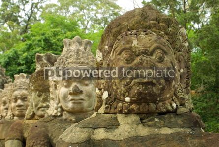 Architecture: Faces of statues near the gates of the Angkor temple complex. An #07411