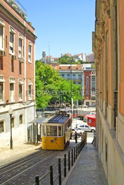 Transportation: Typical yellow tram on the street in Lisbon Portugal  #07568